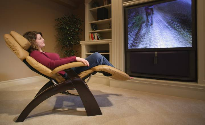 A woman relaxing in a heated recliner