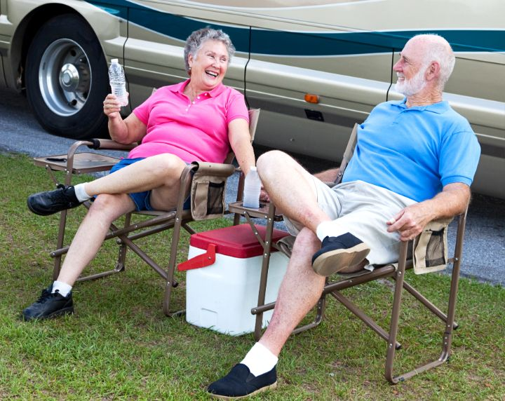 Elderly couple in camping chairs
