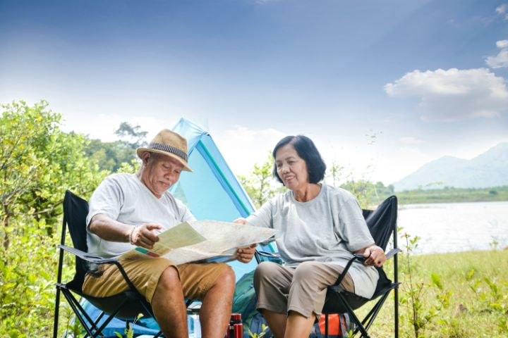 Elderly man and woman in camping chair